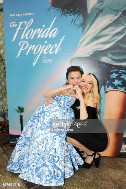 Actresses Brooklynn Prince and Bria Vinaite pose during 'THE FLORIDA PROJECT' Cast Crew Orlando Premiere at The Enzian Theater on October 4 2017 in...