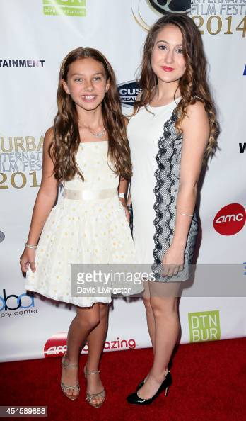 Actresses Caitlin Carmichael and Bella King attend the Burbank International Film Festival opening night at AMC Burbank 16 on September 3 2014 in...