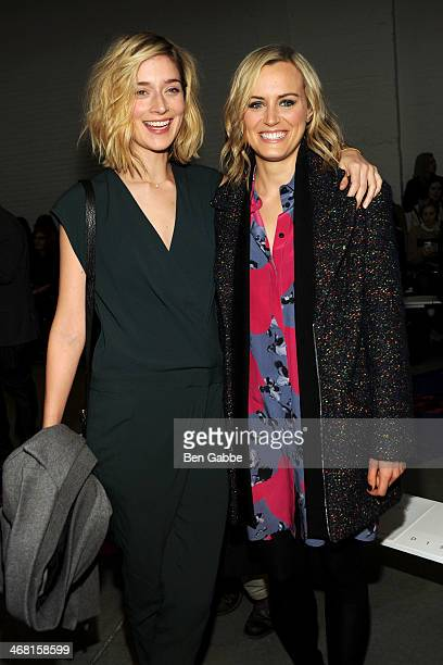 Actresses Caitlin Fitzgerald and Taylor Schilling attend the Thakoon fashion show during MercedesBenz Fashion Week Fall 2014 on February 9 2014 in...