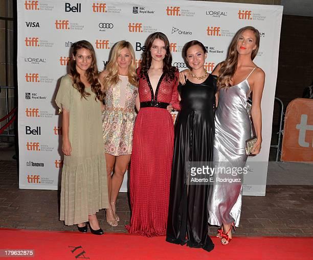Actresses Caitlin Stasey Brooke Butler Sianoa SmitMcPhee Amanda Grace Cooper and Reanin Johannink arrive at the 'All Cheerleaders Die' premiere...
