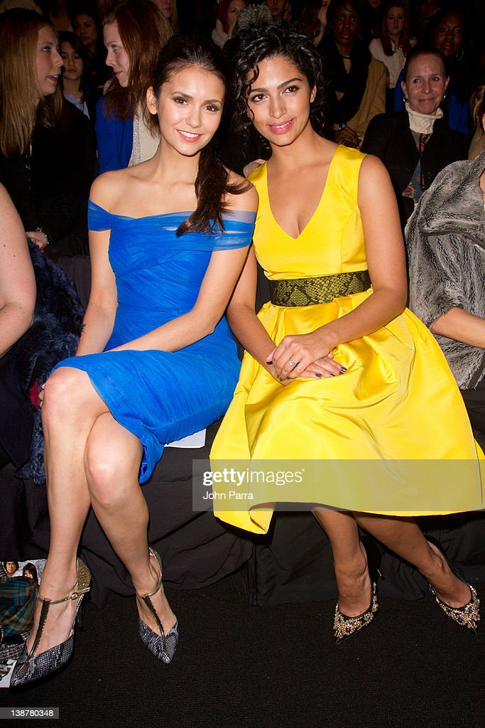 Actresses Camila Alves and Nina Dobrev are seen at the Monique Lhuillier Fall 2012 show at Lincoln Center during Fall 2012 Mercedes-Benz Fashion Week on February 11, 2012 in New York City.