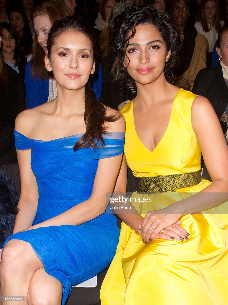 Actresses <a gi-track='captionPersonalityLinkClicked' href=/galleries/search?phrase=Camila+Alves&family=editorial&specificpeople=4501431 ng-click='$event.stopPropagation()'>Camila Alves</a> and <a gi-track='captionPersonalityLinkClicked' href=/galleries/search?phrase=Nina+Dobrev&family=editorial&specificpeople=4397485 ng-click='$event.stopPropagation()'>Nina Dobrev</a> are seen at the Monique Lhuillier Fall 2012 show at Lincoln Center during Fall 2012 Mercedes-Benz Fashion Week on February 11, 2012 in New York City.