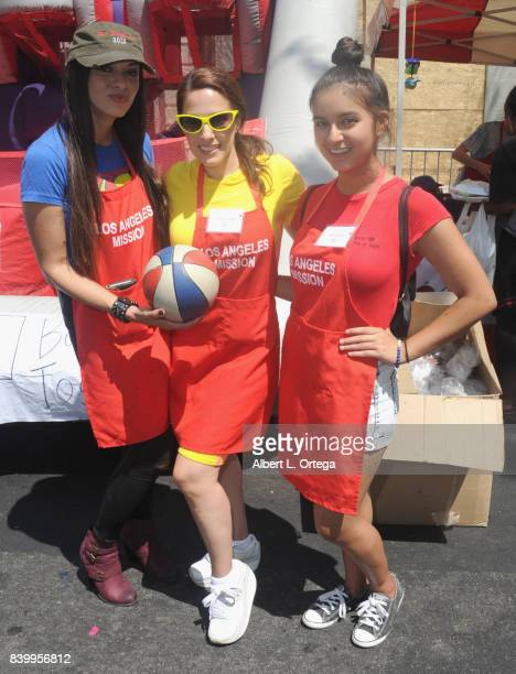 Actresses Carolina De Athey Christina DeRosa and Amber Romero participate in the Los Angeles Mission's End Of Summer Arts And Education Fair held at...