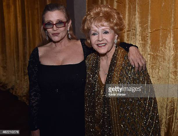 Actresses Carrie Fisher and Debbie Reynolds pose in the trophy room at TNT's 21st Annual Screen Actors Guild Awards at The Shrine Auditorium on...