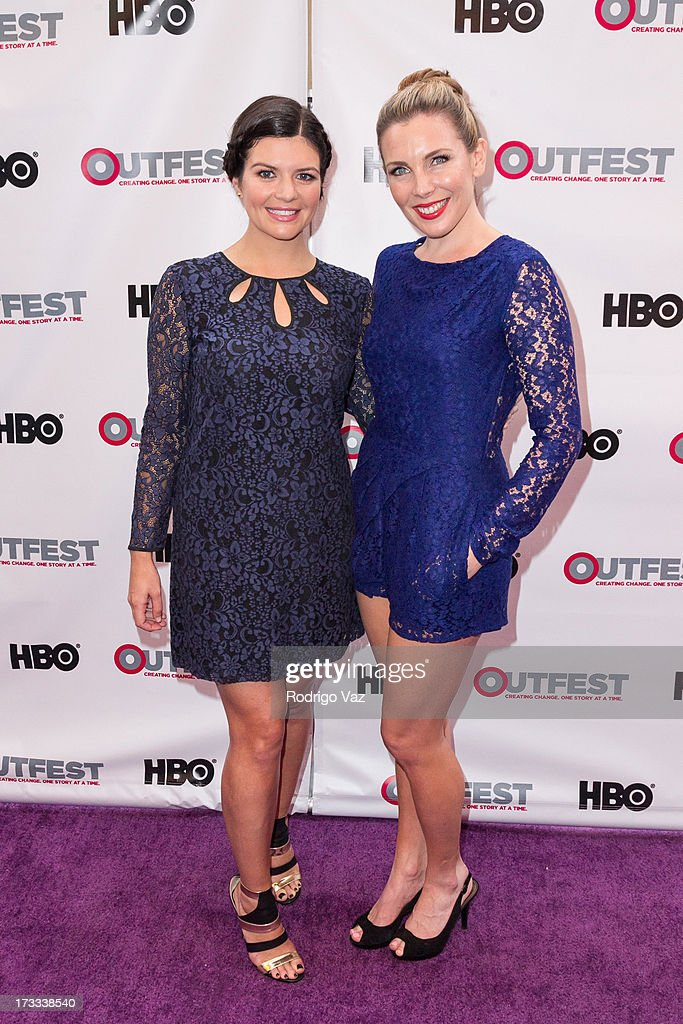 Actresses Casey Wilson (L) and June Diane Raphael arrive at the 13th Annual Outfest Opening Night Gala Of 'C.O.G.' at Orpheum Theatre on July 11, 2013 in Los Angeles, California.