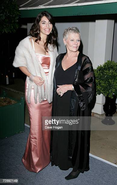Actresses Caterina Murino and Dame Judi Dench attend the Casino Royale After Party held in Berkley Square on November 14 in London England