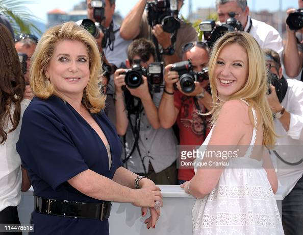 Actresses Catherine Deneuve and Ludivine Sagnier attend the 'Les BienAimes' Photocall during the 64th Cannes Film Festival at the Palais des...
