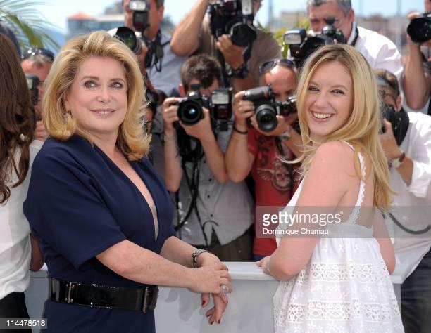 Actresses Catherine Deneuve and Ludivine Sagnier attend the 'Les BienAimes' Photocall during the 64th Cannes Film Festival at the Palais des...