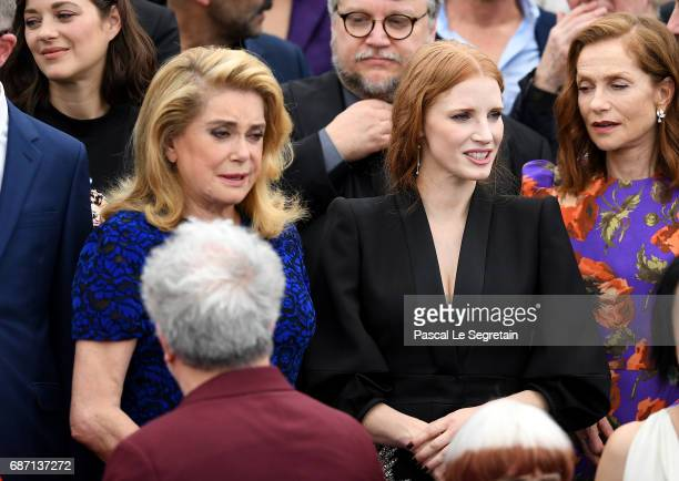 Actresses Catherine Deneuve Jessica Chastain and Isabelle Huppert attend the 70th Anniversary Photocall during the 70th annual Cannes Film Festival...