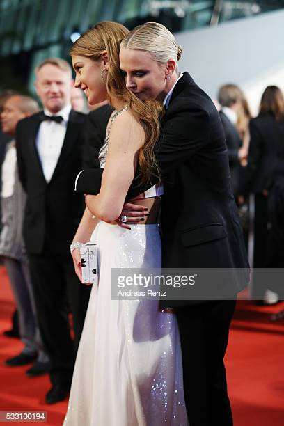 Actresses Charlize Theron and Adele Exarchopoulos embrace each other as they leave 'The Last Face' Premiere during the 69th annual Cannes Film...
