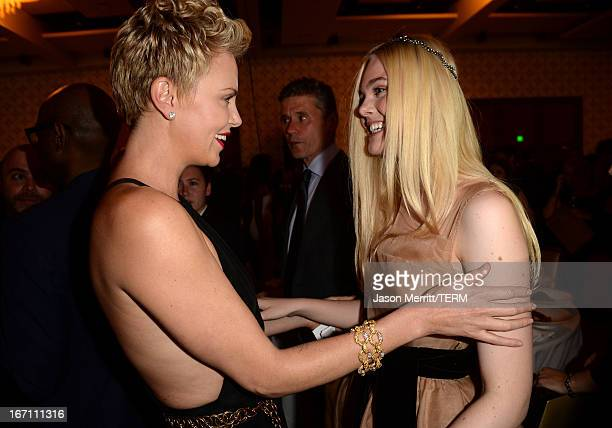 Actresses Charlize Theron and Elle Fanning attend the 24th Annual GLAAD Media Awards at JW Marriott Los Angeles at LA LIVE on April 20 2013 in Los...