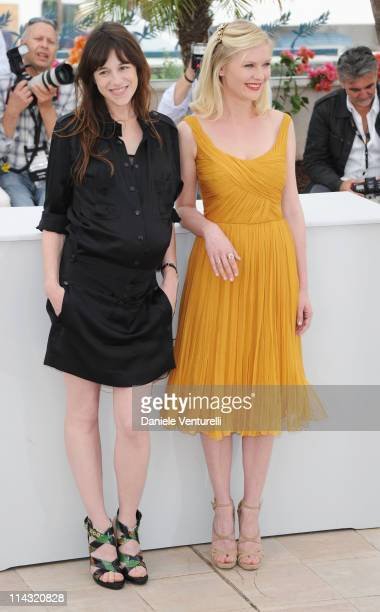 Actresses Charlotte Gainsbourg and Kirsten Dunst attend the 'Melancholia' Photocall during the 64th Cannes Film Festival at the Palais des Festivals...