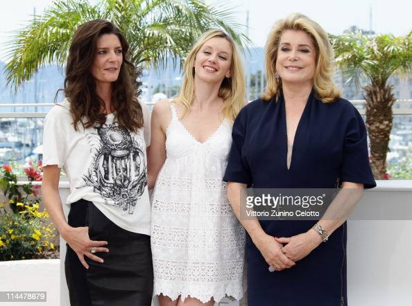 Actresses Chiara Mastroianni and Laudivine SagnierCatherine Deneuve attend the 'Les BienAimes' Photocall at Palais des Festivals during the 64th...