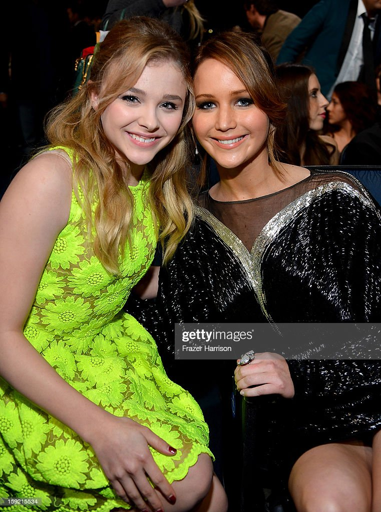 Actresses Chloe Grace Moretz (L) and Jennifer Lawrence attend the 39th Annual People's Choice Awards at Nokia Theatre L.A. Live on January 9, 2013 in Los Angeles, California.