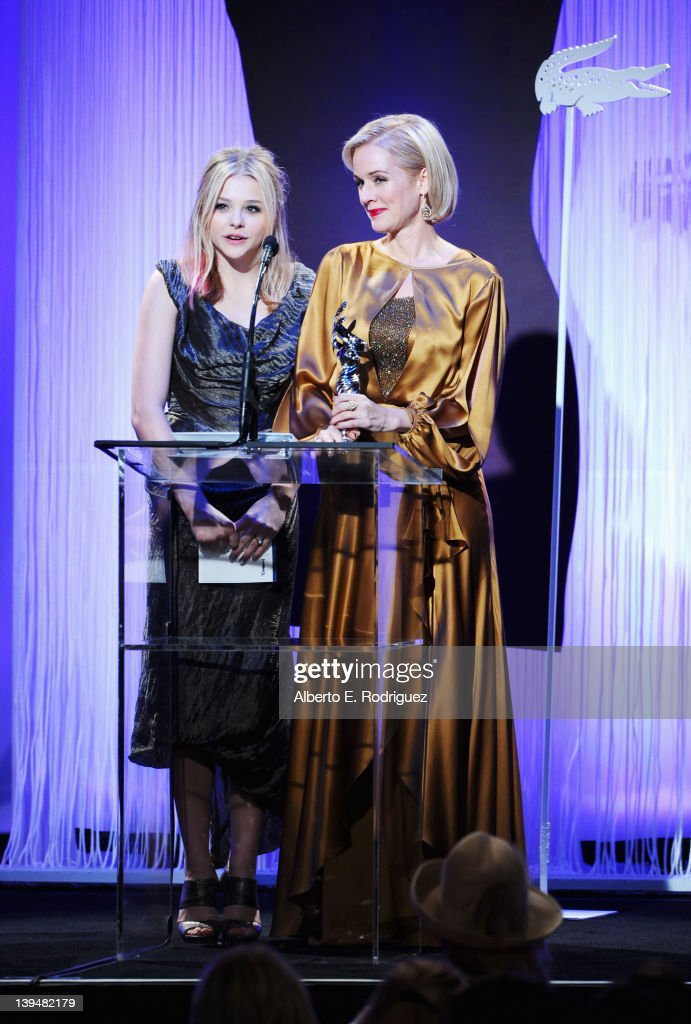 Actresses Chloe Grace Moretz (L) and Penelope Ann Miller onstage during the 14th Annual Costume Designers Guild Awards With Presenting Sponsor Lacoste held at The Beverly Hilton hotel on February 21, 2012 in Beverly Hills, California.