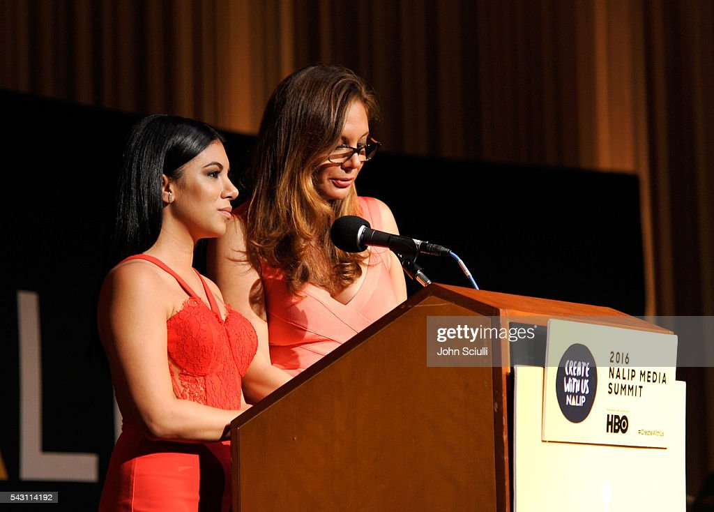 Actresses Chrissie Fit and Alex Meneses speak onstage during the NALIP 2016 Latino Media Awards at Dolby Theatre on June 25, 2016 in Hollywood, California.