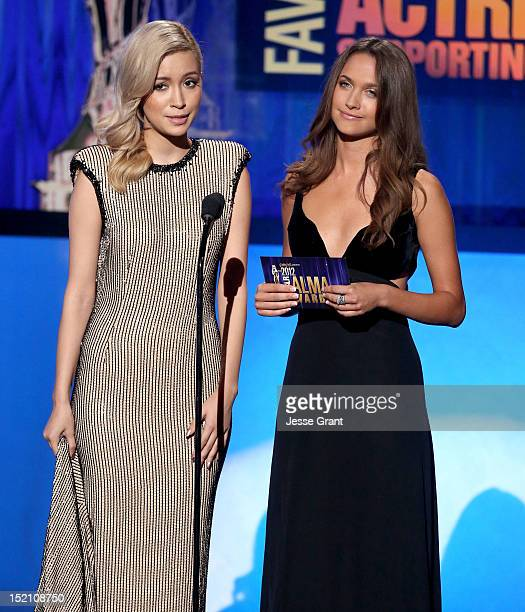 Actresses Christian Serratos and Maiara Walsh present the Favorite TV Actor Supporting Role in a Drama award at the 2012 NCLR ALMA Awards PreShow at...