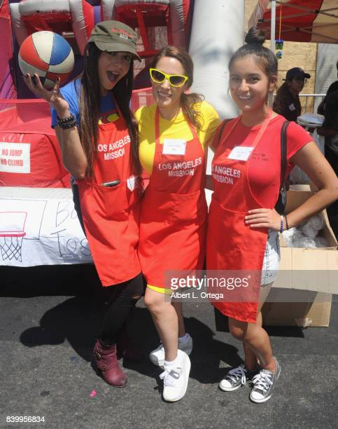 Actresses Christina DeRosa Carolina De Athey and Amber Romero participate in the Los Angeles Mission's End Of Summer Arts And Education Fair held at...