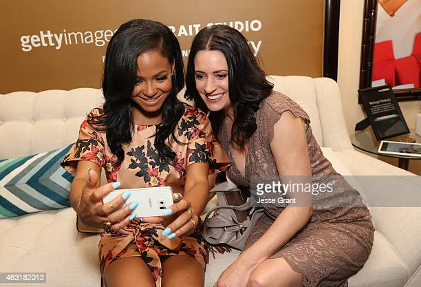 Actresses Christina Milian and Paget Brewster of FOX's 'Grandfathered' attend the Getty Images Portrait Studio powered by Samsung Galaxy at 2015...