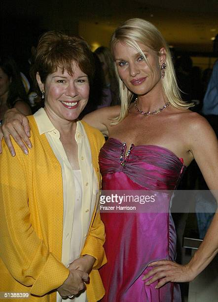 Actresses Christine Estabrook and Nicollette Sheridan mingle at the Desperate Housewives premiere party at Barney's New York October 3 2004 in...