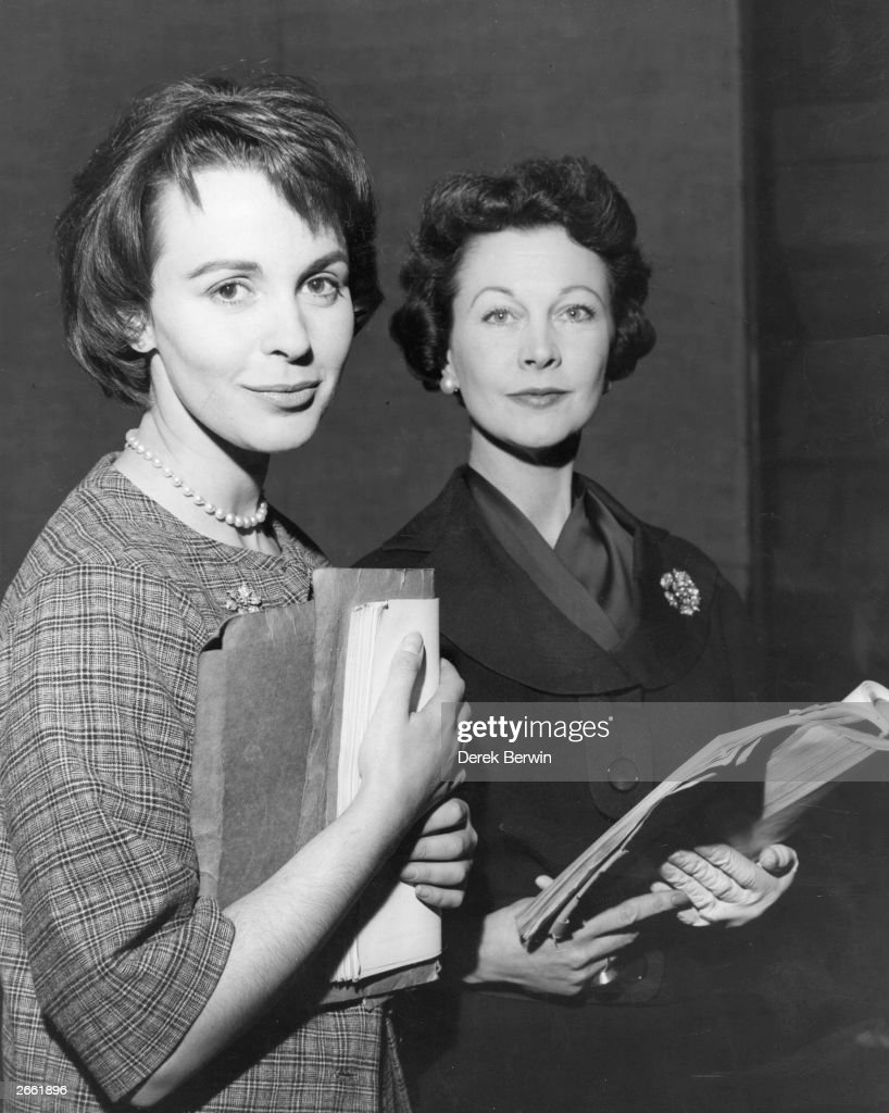 Actresses Claire Bloom (left) and Vivien Leigh studying their scripts during rehearsals of the West End play 'Duel of Angels'.