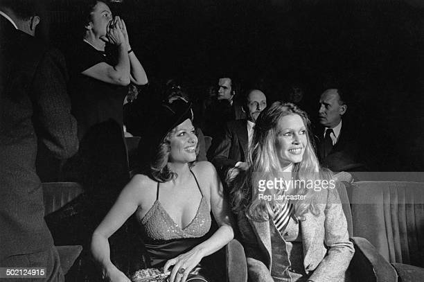 Actresses Claudia Cardinale and Brigitte Bardot at the premiere of 'Les Petroleuses' at the Balzac cinema Paris 17th December 1971