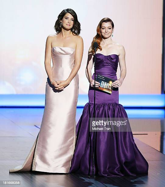 Actresses Cobie Smulders and Alyson Hannigan speak onstage during the 65th Annual Primetime Emmy Awards held at Nokia Theatre LA Live on September 22...