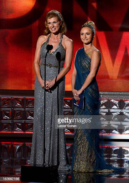 Actresses Connie Britton and Hayden Panettiere speak onstage at the 64th Primetime Emmy Awards at Nokia Theatre LA Live on September 23 2012 in Los...