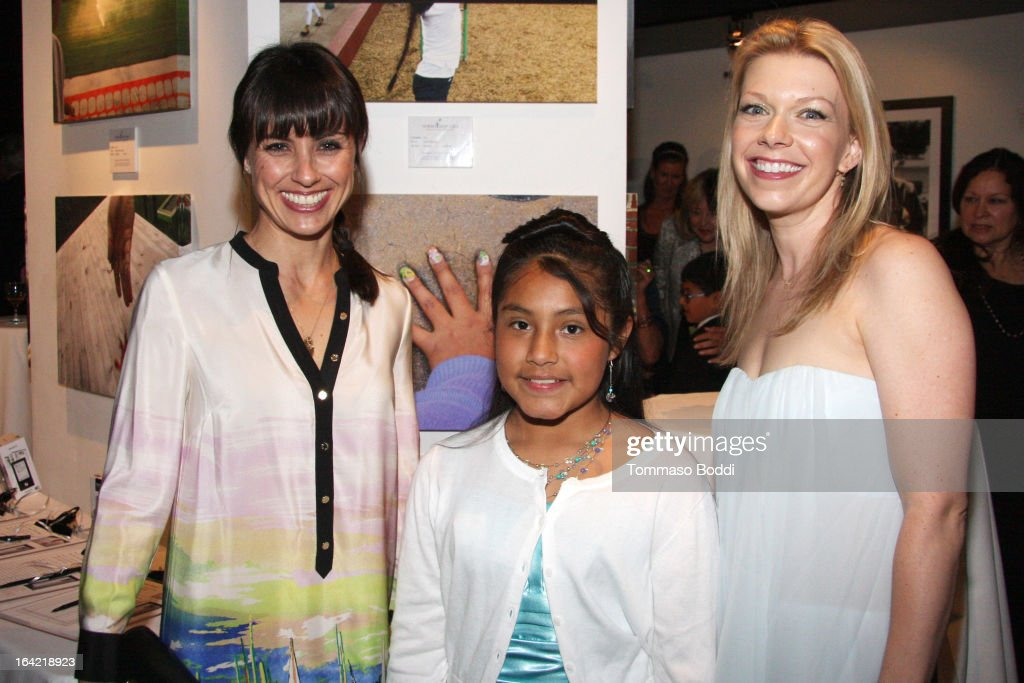 Actresses <a gi-track='captionPersonalityLinkClicked' href=/galleries/search?phrase=Constance+Zimmer&family=editorial&specificpeople=217359 ng-click='$event.stopPropagation()'>Constance Zimmer</a> (L) and Mary Elizabeth Ellis pose with one of the children of Hollygrove at the 1st Annual Norma Jean Gala held at the TCL Chinese Theatre on March 20, 2013 in Hollywood, California.