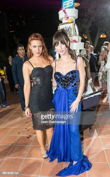 Actresses Courtney Hope and Jacqueline MacInnes Wood pose for a photo on the dance floor at the 'The Bold and The Beautiful' 30th Anniversary Party...