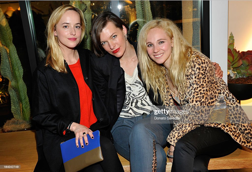 Actresses Dakoda Johnson Milla Jovovich and Juno Temple attend Isabel Marant Milla Jovovich BBQ party to celebrate the 1st Year of he LA Shop at...
