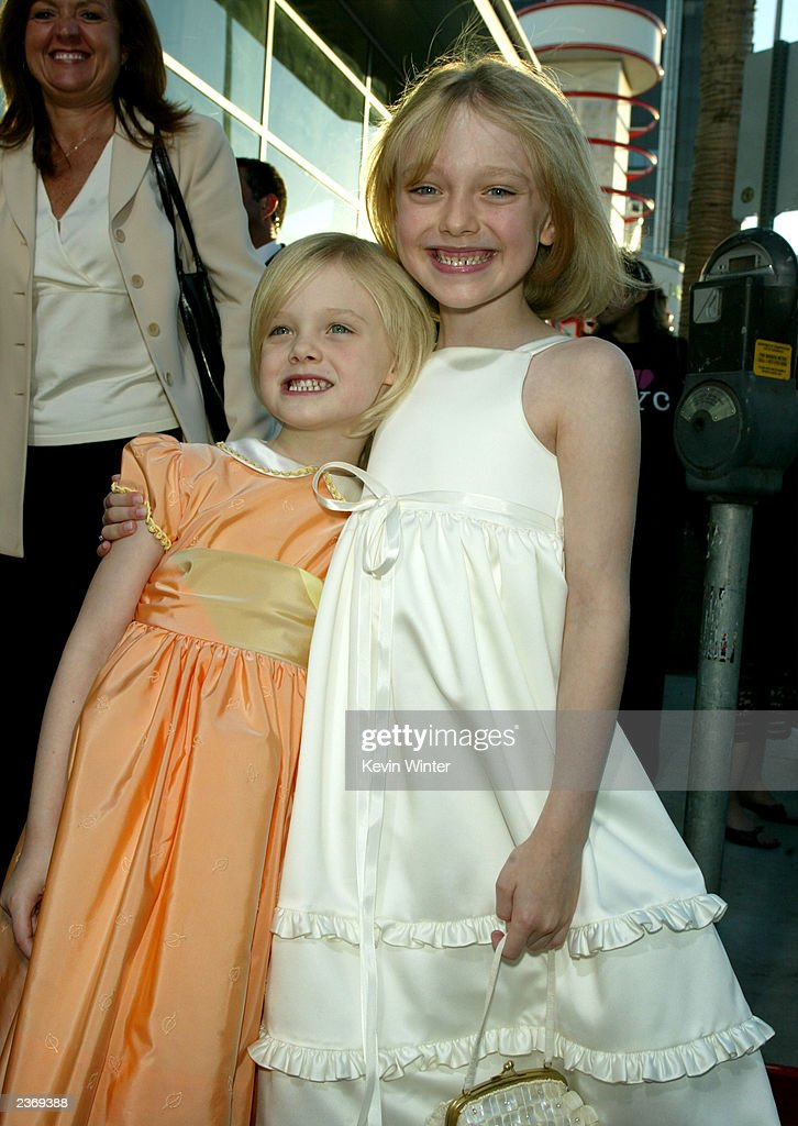 Actresses Dakota and <a gi-track='captionPersonalityLinkClicked' href=/galleries/search?phrase=Elle+Fanning&family=editorial&specificpeople=2189940 ng-click='$event.stopPropagation()'>Elle Fanning</a> attends the MGM Pictures Los Angeles premiere of the film 'Uptown Girls' at the ArcLight Cinerama Dome August 4, 2003 in Hollywood, California.