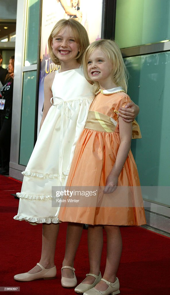 Actresses Dakota and Elle Fanning attends the MGM Pictures Los Angeles premiere of the film 'Uptown Girls' at the ArcLight Cinerama Dome August 4, 2003 in Hollywood, California.