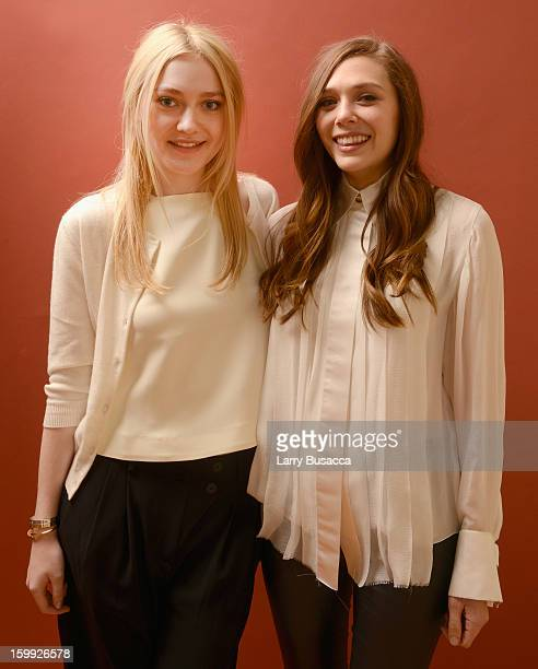 Actresses Dakota Fanning and Elizabeth Olsen pose for a portrait during the 2013 Sundance Film Festival at the Getty Images Portrait Studio at...