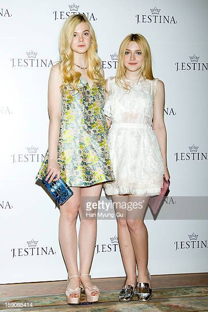 Actresses Dakota Fanning and Elle Fanning attend a promotional event for the 2013 JESTINA SS presentation at Shilla Hotel on January 7 2013 in Seoul...