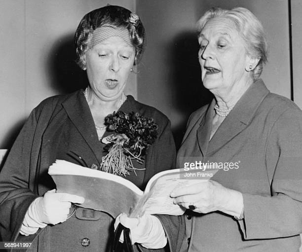 Actresses Dame Sybil Thorndike and Marie Lohr rehearsing the script for the Noel Coward play 'Waiting in the Wings' at the YMCA on Great Russell...