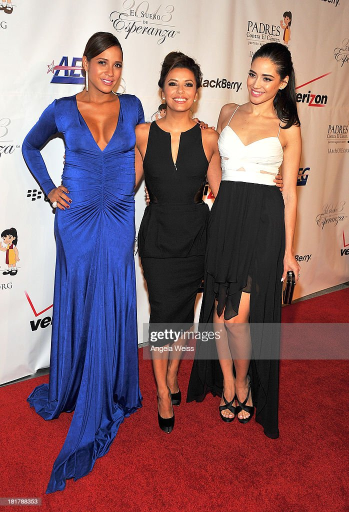 L-R) Actresses <a gi-track='captionPersonalityLinkClicked' href=/galleries/search?phrase=Dania+Ramirez&family=editorial&specificpeople=213153 ng-click='$event.stopPropagation()'>Dania Ramirez</a>, <a gi-track='captionPersonalityLinkClicked' href=/galleries/search?phrase=Eva+Longoria&family=editorial&specificpeople=202082 ng-click='$event.stopPropagation()'>Eva Longoria</a> and <a gi-track='captionPersonalityLinkClicked' href=/galleries/search?phrase=Edy+Ganem&family=editorial&specificpeople=9168634 ng-click='$event.stopPropagation()'>Edy Ganem</a> arrive at the Padres Contra El Cancer 13th annual 'El Sueno de Esperanza' gala on September 24, 2013 in Los Angeles, California.