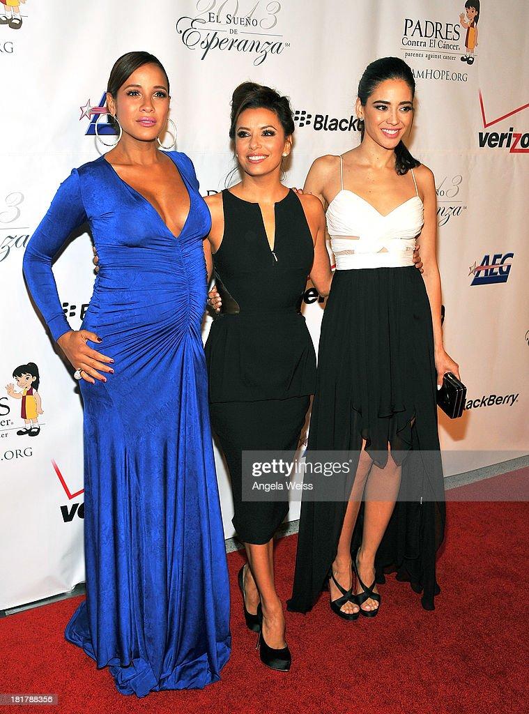 L-R) Actresses Dania Ramirez, Eva Longoria and Edy Ganem arrive at the Padres Contra El Cancer 13th annual 'El Sueno de Esperanza' gala on September 24, 2013 in Los Angeles, California.