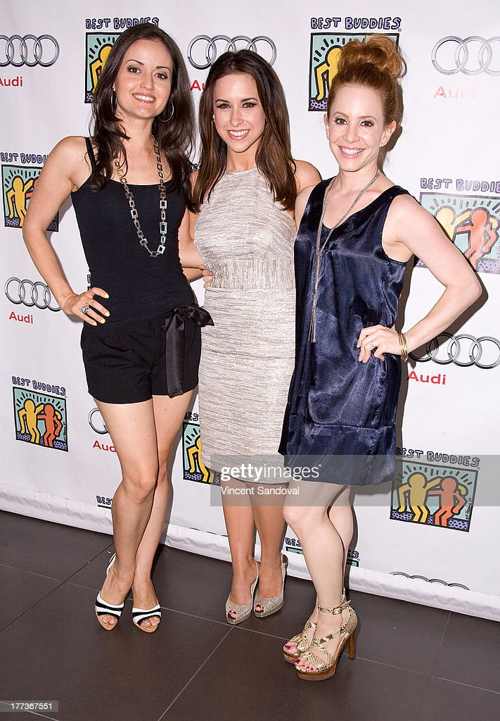 Actresses Danica McKellar, Lacey Chabert and Amy Davidson attend the Best Buddies poker event at Audi Beverly Hills on August 22, 2013 in Beverly Hills, California.
