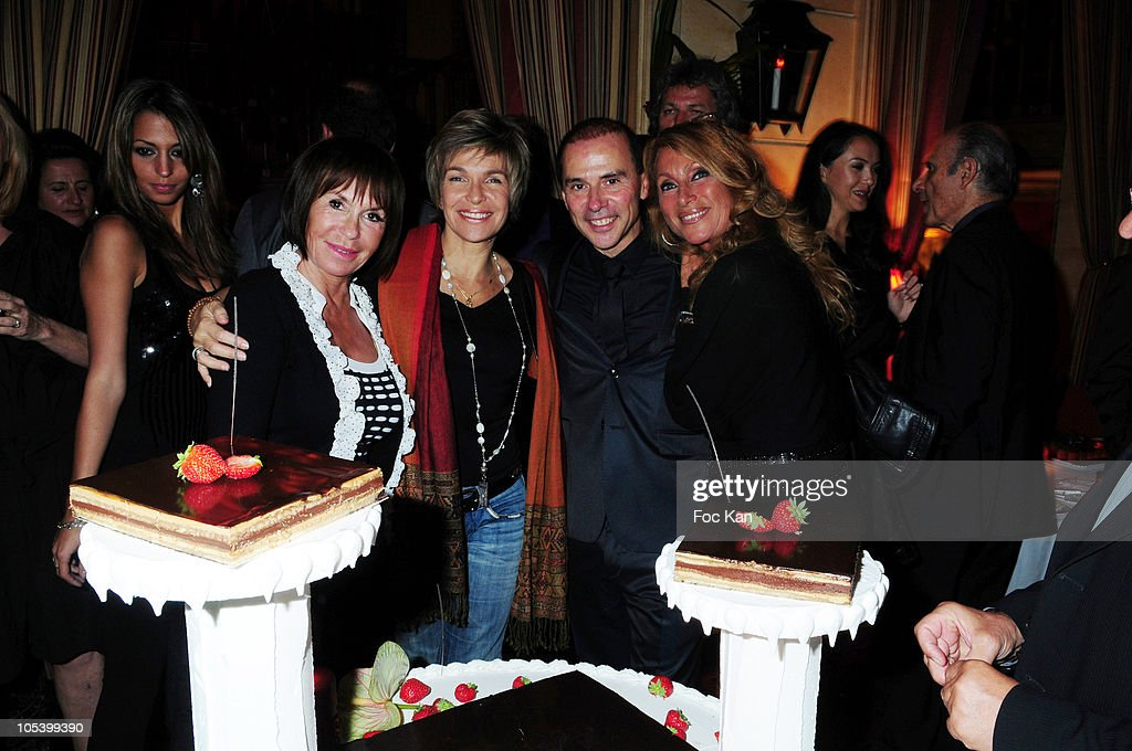 Actresses Daniele Evenou, Veronique jeannot, artistic agent Patrick Goavec and singer <a gi-track='captionPersonalityLinkClicked' href=/galleries/search?phrase=Liane+Foly&family=editorial&specificpeople=961880 ng-click='$event.stopPropagation()'>Liane Foly</a> attend the Patrick Goavec Birthday Party at the Berkeley Club on September 14, 2009 in Paris, France.