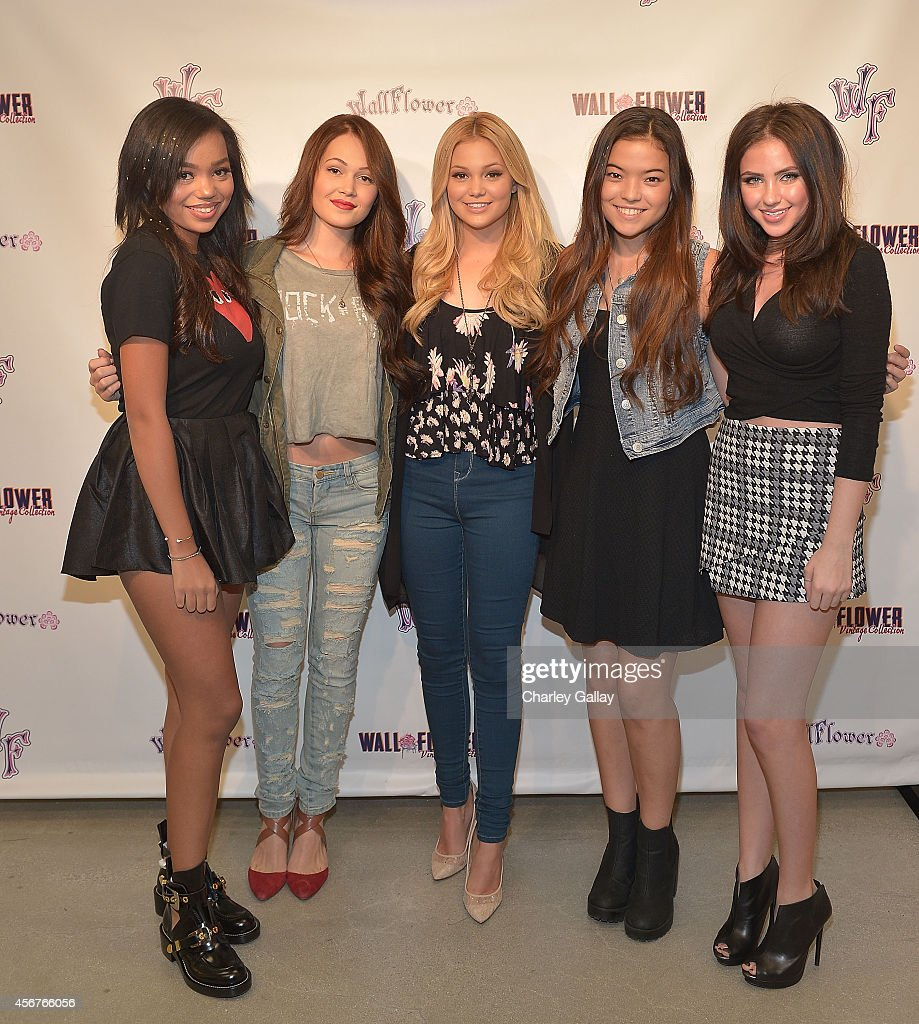 Actresses Daphne Blunt Kelli Berglund Olivia Holt Piper Curda and Ryan Newman attend Wallflower Jeans Fashion Night Out With Olivia Holt on October 6...