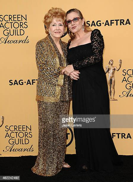 Actresses Debbie Reynolds and Carrie Fisher pose in the press room at the 21st annual Screen Actors Guild Awards at The Shrine Auditorium on January...