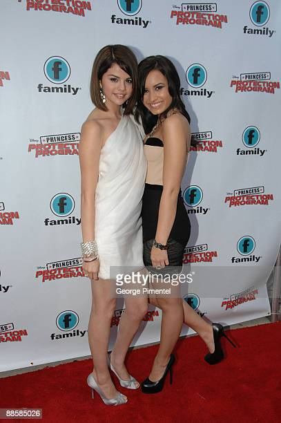 Actresses Demi Lovato and Selena Gomez attend the Red Carpet Premiere For Disney's 'Princess Protection Program' at the Queen Elizabeth Theatre on...
