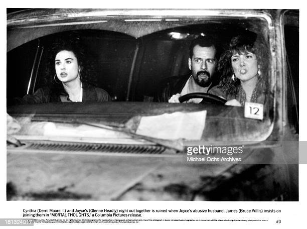 Actresses Demi Moore and Glenne Headly with actor Bruce Willis on set of the Columbia Pictures movie ' Mortal Thoughts' in 1991