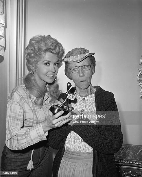 Actresses Donna Douglas as Elly May Clampett left and Irene Ryan as Granny Daisy Moses hold the Australian television industry's award the 'Logie'...