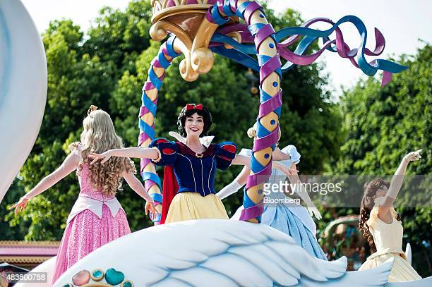 Actresses dressed as Snow White and other characters perform during a parade at Walt Disney Co's Disneyland Resort in Hong Kong China on Friday Aug 7...