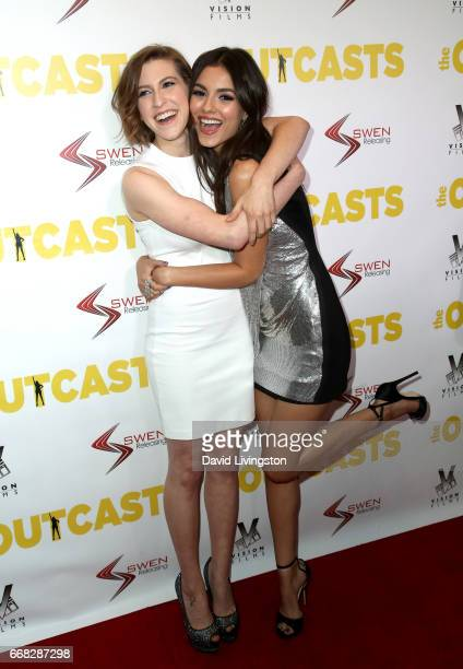 Actresses Eden Sher and Victoria Justice attend the premiere of Swen Group's 'The Outcasts' at Landmark Regent on April 13 2017 in Los Angeles...