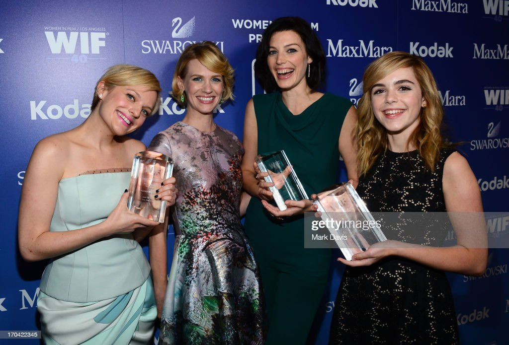 Actresses Elisabeth Moss, January Jones, Jessica Pare and Kiernan Shipka attend Women In Film's 2013 Crystal + Lucy Awards at The Beverly Hilton Hotel on June 12, 2013 in Beverly Hills, California.
