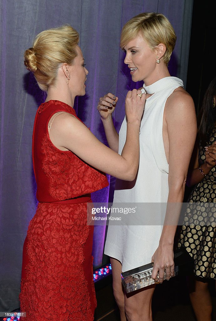 Actresses <a gi-track='captionPersonalityLinkClicked' href=/galleries/search?phrase=Elizabeth+Banks&family=editorial&specificpeople=202475 ng-click='$event.stopPropagation()'>Elizabeth Banks</a> (L) and <a gi-track='captionPersonalityLinkClicked' href=/galleries/search?phrase=Charlize+Theron&family=editorial&specificpeople=171250 ng-click='$event.stopPropagation()'>Charlize Theron</a> attend Variety's 5th Annual Power of Women event presented by Lifetime at the Beverly Wilshire Four Seasons Hotel on October 4, 2013 in Beverly Hills, California.