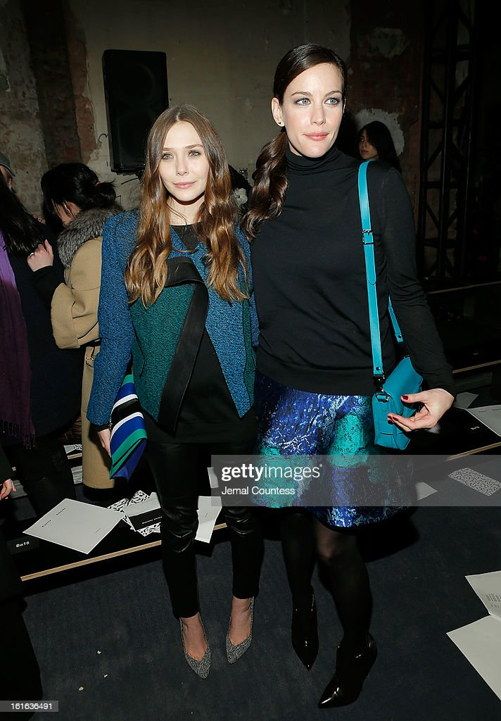 Actresses Elizabeth Olson and <a gi-track='captionPersonalityLinkClicked' href=/galleries/search?phrase=Liv+Tyler&family=editorial&specificpeople=202094 ng-click='$event.stopPropagation()'>Liv Tyler</a> attend the Proenza Schouler fall 2013 fashion show during Mercedes-Benz Fashion Week on February 13, 2013 in New York City.